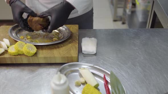 Thumbnail for Successful Chef Pouring Raw Piece of Meat with Soy Sauce Before Baking in the Oven in the Restaurant