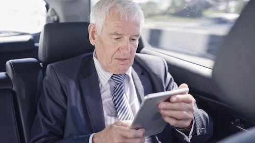 Businessman in Car Late for Meeting