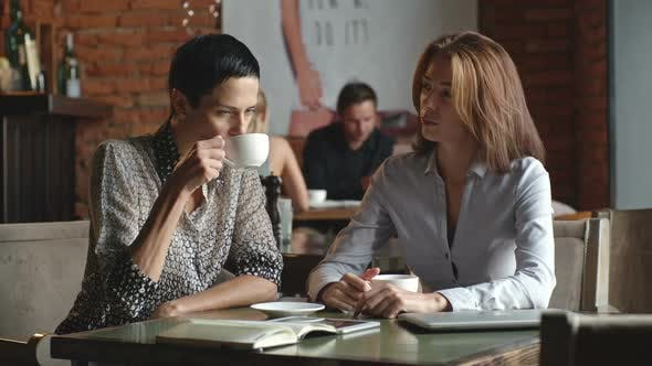 Thumbnail for Female Business Partners Drinking Coffee