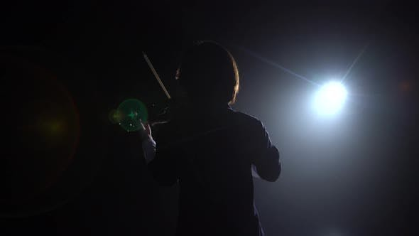 Thumbnail for Professional Playing the Violin in a Dark Studio with a Lantern From It Glare