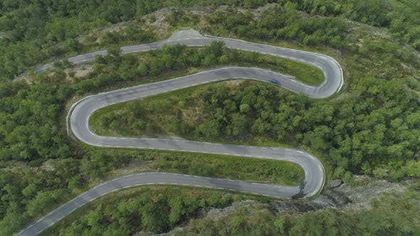 Thumbnail for Blue Car Is Going on Mountain Winding Road in Norway. Green Forest. Aerial Vertical Top-Down View