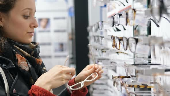 Thumbnail for Attractive Brunette in Leather Jacket Tries on New Glasses