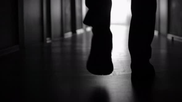 Thumbnail for Silhouette of Male Legs Walking