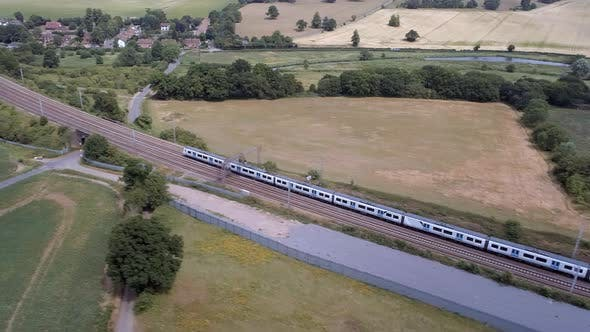 Two Commuter Trains Passing in the Country