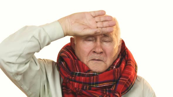 Thumbnail for Sick Grandpa Wearing a Scarf Touching Forehead Having Fever