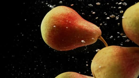 Thumbnail for Fresh Red and Yellow Pears Fruits Falling Into Water with Splash and Air Bubbles