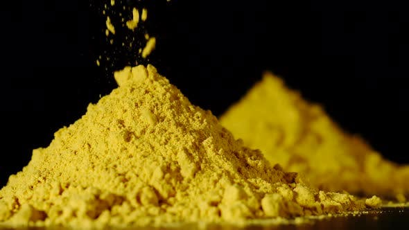 Thumbnail for SLOW MOTION:Yellow Turmeric Powder Pouring On A Table