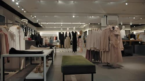 Timelapse of Empty Clothes Store with Two Women Customers Choosing Clothes