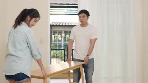 Korean family carry chair together house improvement, modern furniture move object.