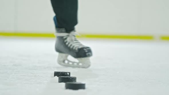 Thumbnail for Hockey Player Practicing Shooting Pucks