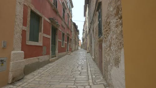 Cobblestone street with old houses