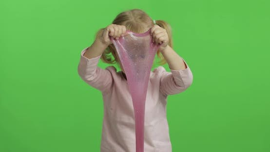 Thumbnail for Kid Playing with Hand Made Toy Slime. Child Having Fun Making Pink Slime