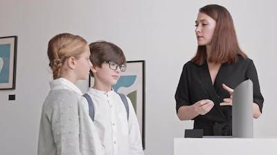 Museum Worker Talking to Kids
