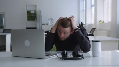Energy Wasted Man Can't Focuse on His Work