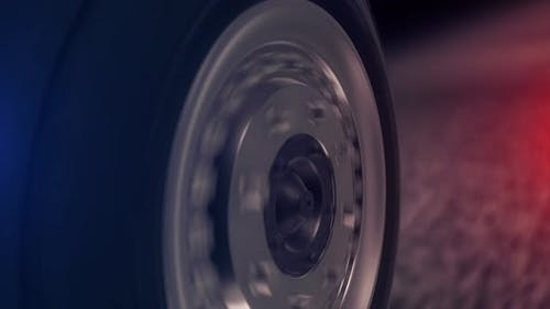 Side view of abstract car wheel driving on black road