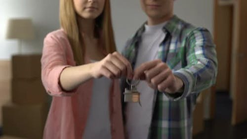 Happy Couple Smiling Showing Keys From New Apartment, Affordable Bank Lending