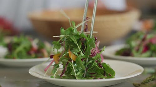 Salad is placed on plate
