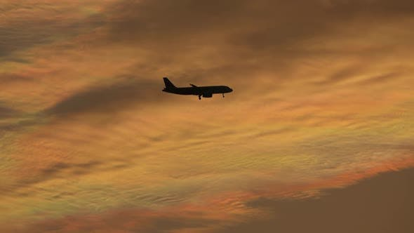 Thumbnail for Silhoutte of Plane Flying Over Sunset Sky