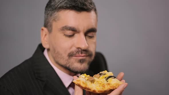 Hungry Office Worker Eating Appetizing Cheese Pizza, Man Enjoying Fastfood