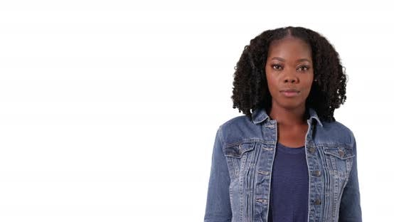 Thumbnail for Portrait of attractive black woman in jean jacket in studio with copyspace