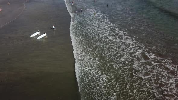 Surfers Go To the Sea