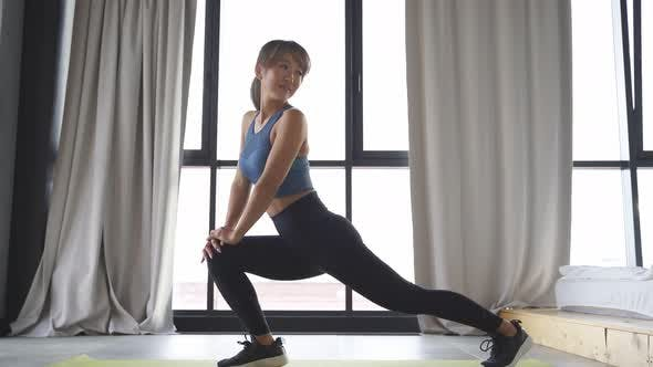 Beautiful Woman Doing Exercises on a Fitness Mat in Her Living Room Exercises To Increase Body