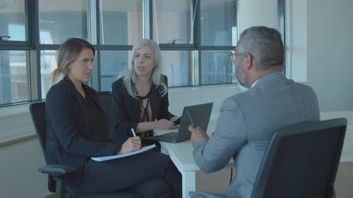 Serious Female Employer and HR Manager