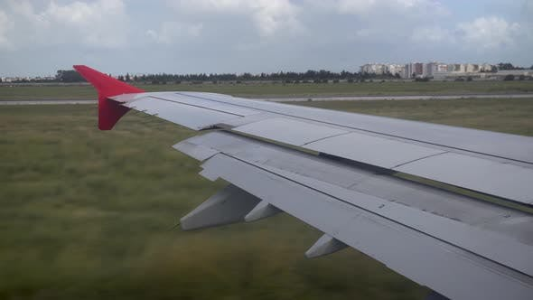 Thumbnail for The Plane Travels on the Ground. View From the Airplane Window To the Wing.
