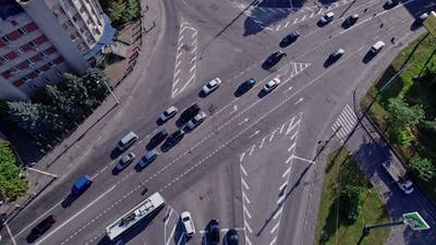 Traffic Crossing Busy Intersection at City