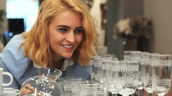 Thumbnail for The Girl Is Choosing New Wineglasses for Home