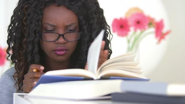 Thumbnail for Black teen studying hard for her exam