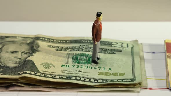 Cover Image for The Dollar vs the Peso with Business Figurines