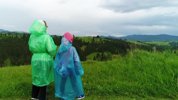 Thumbnail for Mother and Daughter in Raincoats