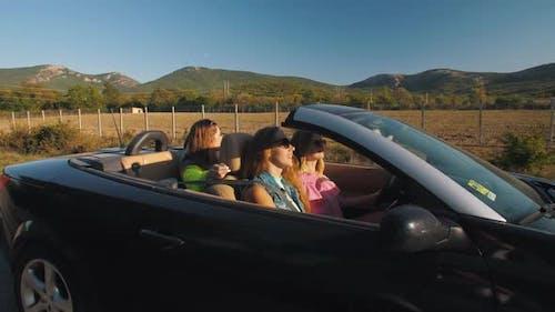 Girlfriends in a Convertible Car