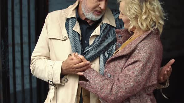 Elderly Couple Hugging Outdoors