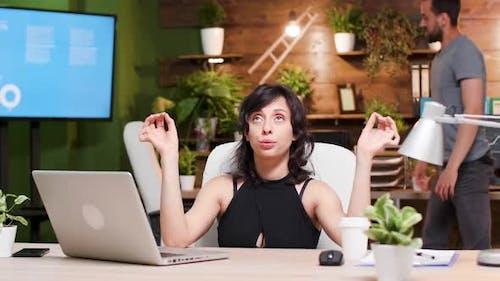 Beautiful Businesswoman Tries To Relieve Stress