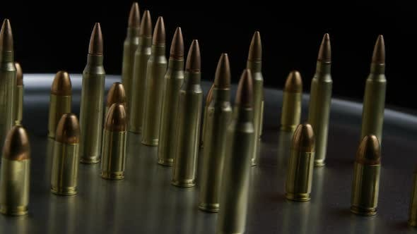 Thumbnail for Cinematic rotating shot of bullets on a metallic surface - BULLETS