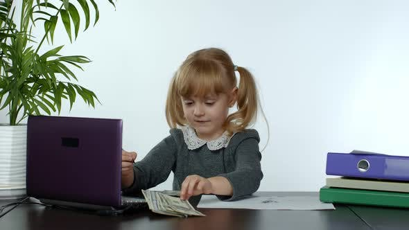 Child Girl Boss Counting Dollar Cash Bills, Baby Businesswoman Kid with Money Is Sitting at Office