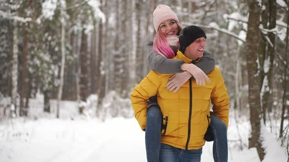 Thumbnail for Happy Loving Couple Walking in Snowy Winter Forest, Spending Christmas Vacation Together. Outdoor