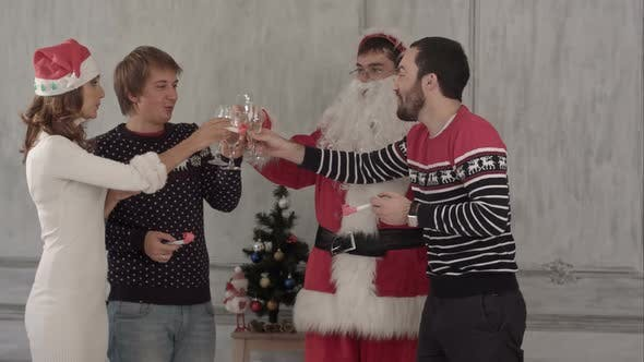 Thumbnail for Friends Celebrate New Year and Christmas They Clink Glasses and Drink Champagne