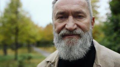 Portrait of Smiling Bearded Man in Street