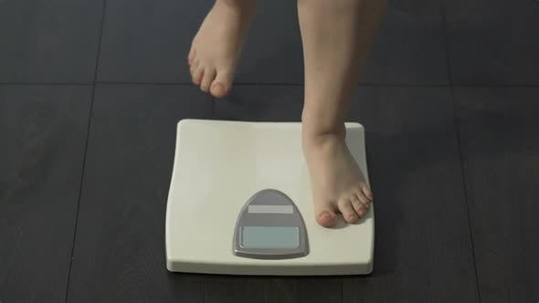 Thumbnail for Female Stepping on Home Scales to Measure Weight, Obesity, Problems with Health