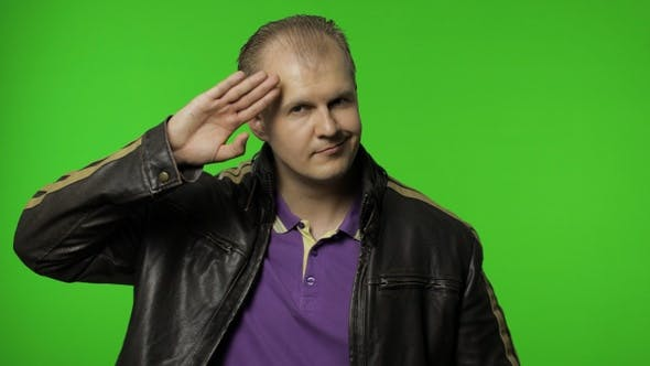 Thumbnail for Rocker Man Saluting with Hand and Pretending To Listen Order. Guy Biker on Chroma Key Background