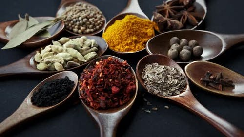 Various Indian Spices of Rotation Black Background