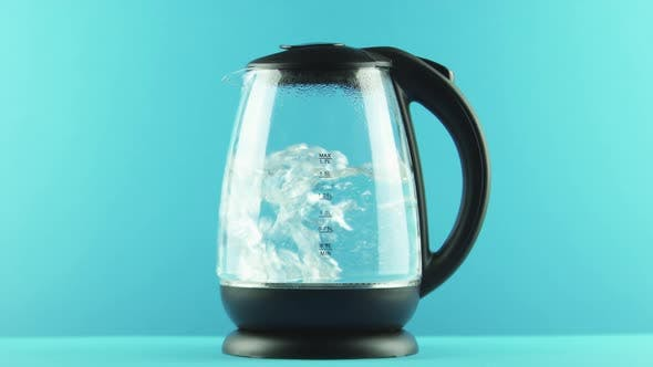 An Electric Kettle with Transparent Walls. Process of Boiling. Full Shot
