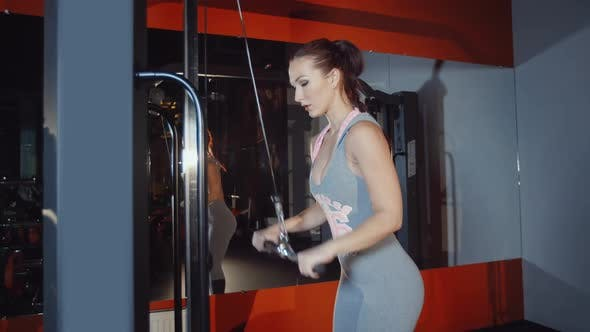 Thumbnail for Caucasian Female Sportsman Do Biceps Hand Muscles Workout Exercise in Gym
