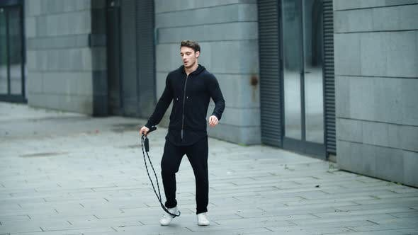 Thumbnail for Fit Man Training on Skipping Rope Outdoor. Male Athlete Training with Jump Rope