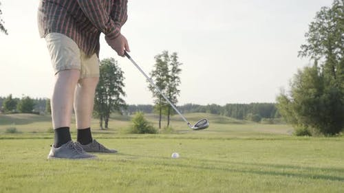 Unrecognized Man Playing Golf Hitting Golf Ball on the Golf Course