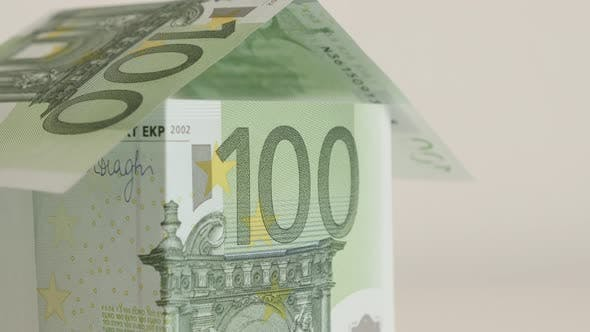 Thumbnail for House made with hundred euro banknotes close-up 4K 2160p 30fps UltraHD  tilting   footage - Concept