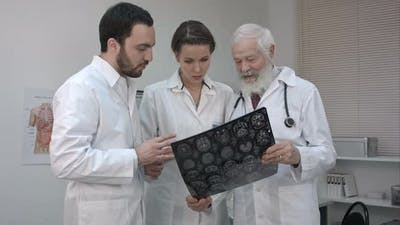 Group of Doctors Checking an MR Exposure